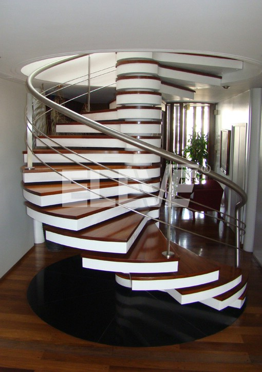 escalera caracol con peldaos atravesados por eje central elegante baranda - Escaleras De Caracol